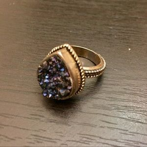 Jewelry - Sparkly blue stone ring with gold band.